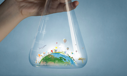 Hand holding glass tube with Earth planet inside. Elements of this image are furnished by NASA