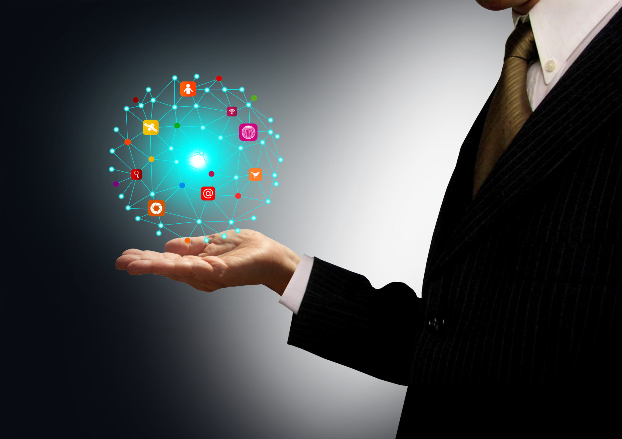 Businessman holding a ball with information technology icons